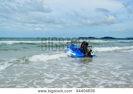 Blue Scooter And Sea