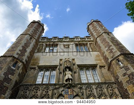 Exterior and Entrance of St Johns College Chapel, Designed by Sir George Gilbert Scott in 1861, under a Blue Sky with White Clouds, University of Cambridge, England
