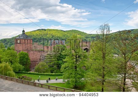 Ruins of Castle Heidelberg and Fortress Grounds as seen through Lush Green Trees in Hillsides of Heidelberg, Baden-Wurttemberg, Germany