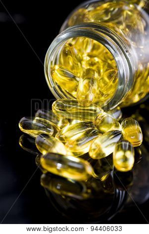Fish Oil On Black Background