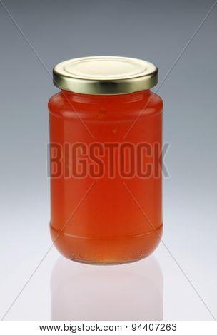 tangerine or citrus fruit jam in the glass container