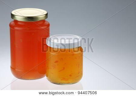 tangerine and pineapple fruit jam in the glass container