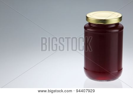 cranberry fruit jam in the glass container