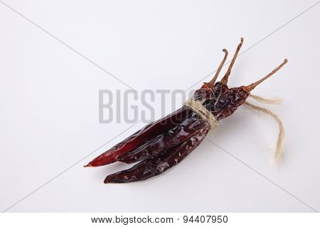 bunch of the dried chilli on the white background