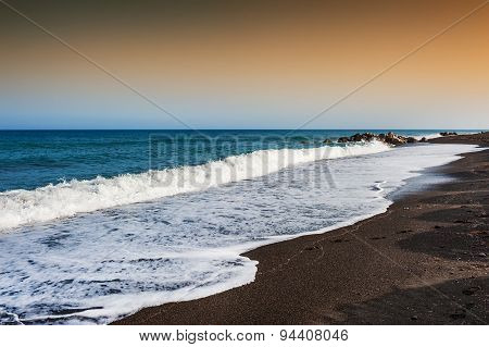 Beautiful Beach With Turquoise Water And Black Sand.