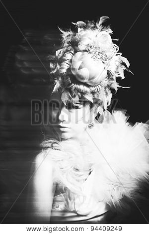 Studio Shoot Of Woman With Creative Hairstyle, Makeup And Dress. Exotic Bird. Black And White
