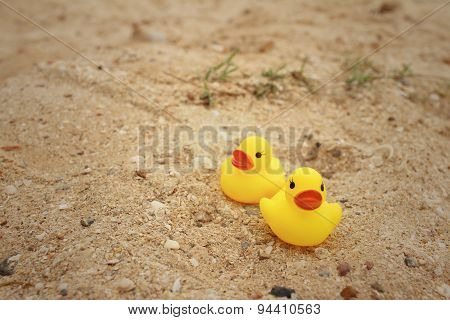 Yellow Rubber Duck On Background Of Sand.