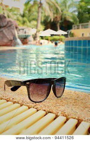 Sunglasses At The Swimming Pool Of The Hotel.