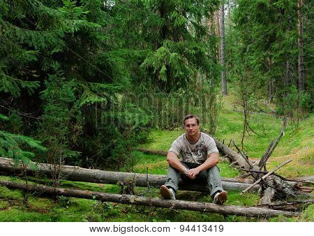 Man with his dog playing in the forest