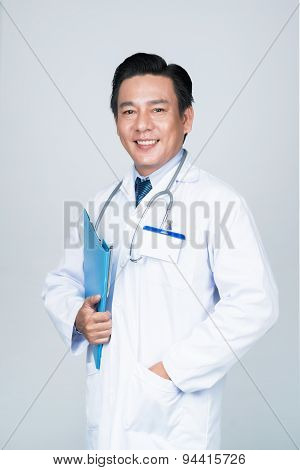Cheerful Asian physician