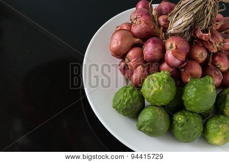 Bergamot And Shallot In A Plate On Black Background