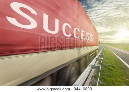 Truck On Road In Motion Blur With Success Text