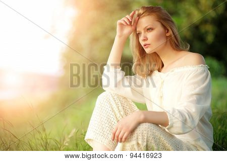 Young Lady In Sunset Near River