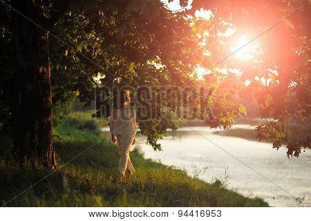 Beautiful Woman In Sunset Near River