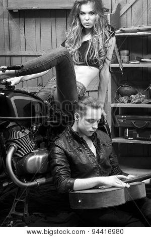 Passionate Couple In Garage