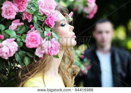 Lady And Man Near Rose Bush