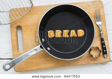 Alphabet Crackers Word Bread Putting In Pan