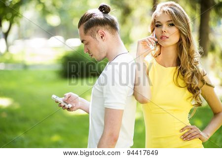 Boy And Girl Chatting On Phones