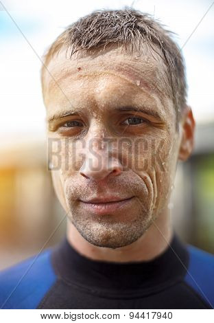 Portrait of a handsome young man in  diving suit