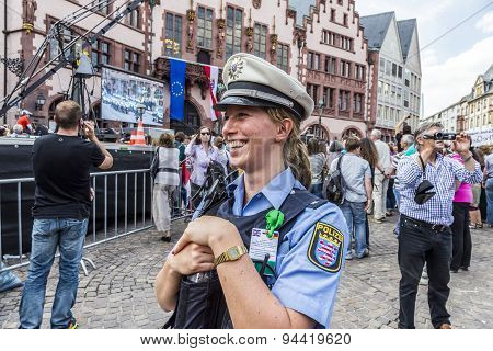 Friendly Police Woman Pays Attention For The Visit Of Queen Elizabeth Ii In Frankfurt