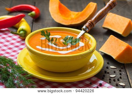 Squash soup in yellow bowl