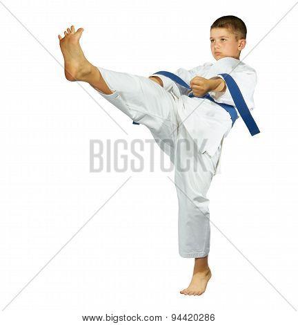 A boy with a blue belt is beating kick mae-geri