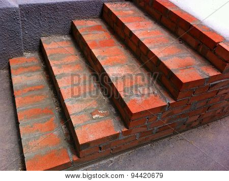 The Steps Of A New Red Brick Staircase