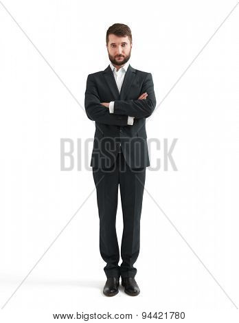portrait of assured businessman in formal wear with folded hands over white background