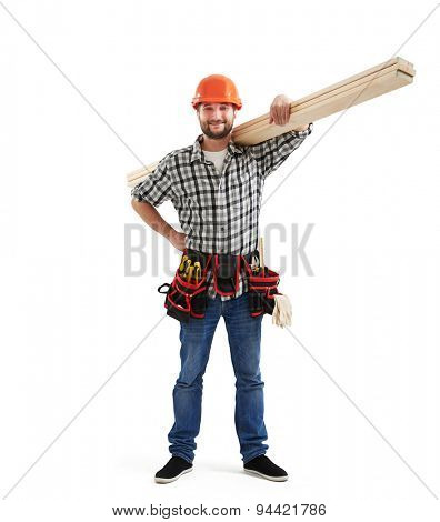 smiley builder in uniform holding long wooden boards. isolated on light grey background