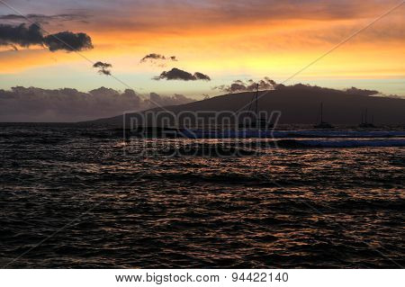 Sunset at the ocean with mountains