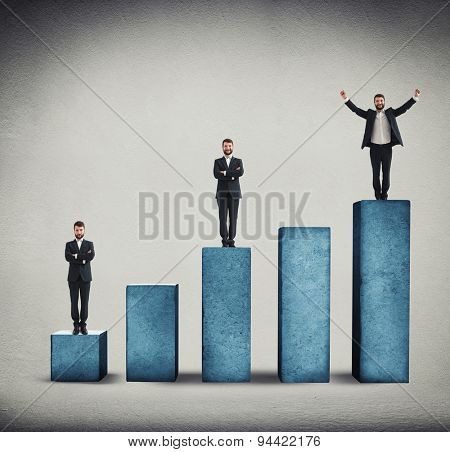 sad, smiley and happy men standing on graph made from concrete over grey background