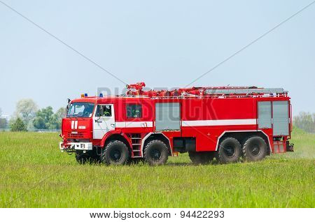 BORYSPIL, UKRAINE - MAY, 20, 2015: Red firetruck Kamaz ride on alarm for instruction for fire suppre
