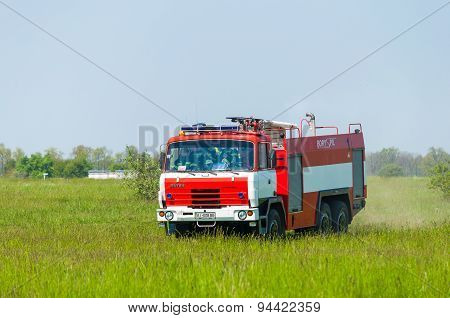BORYSPIL, UKRAINE - MAY, 20, 2015: Fire-brigade on firetruck Tatra ride on alarm for instruction for