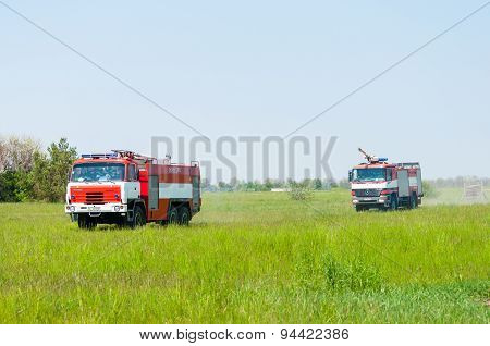 BORYSPIL, UKRAINE - MAY, 20, 2015: Fire-brigade on firetruck Tatra and Mercedes ride on alarm for in