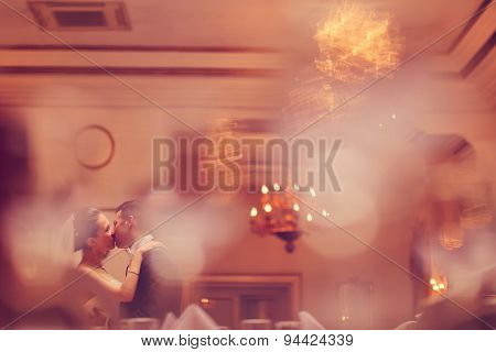 Bride And Groom Dancing In A Restaurant