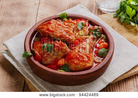 chicken in tomato sauce in a bowl chakhokhbili