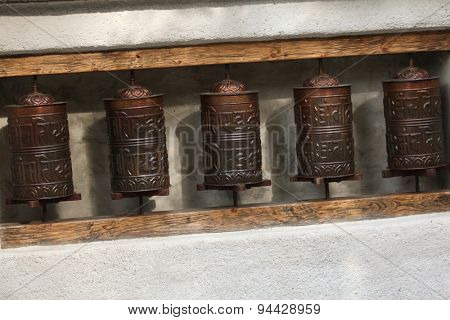 Tibetan prayer wheels used by Tibetans practicing Buddhism.