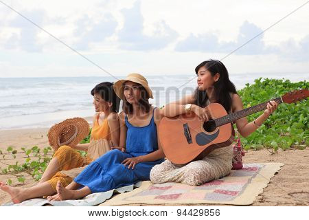 Portrait Group Of Young Asian Woman Playing Guitar In Sea Beach Picnic Party At Sea Side With Happin