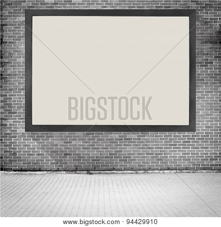 Black wooden frame with copy space hanging on grey brick wall near the street. Vector illustration