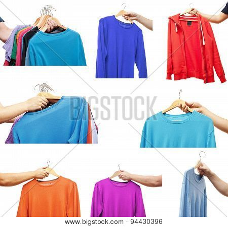 men hand holding hangers with sweaters and t-shirts