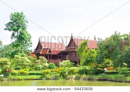 Traditional Thai House In Garden Beside River