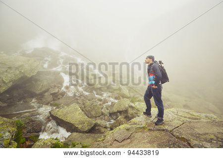 Traveler In Mountains