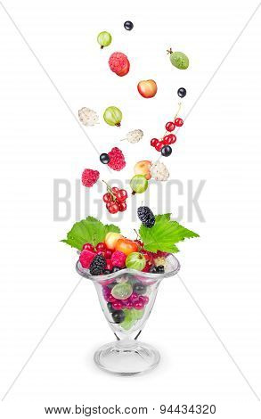 Salad With Fresh Falling Fruits And Berries In Glass On White Background