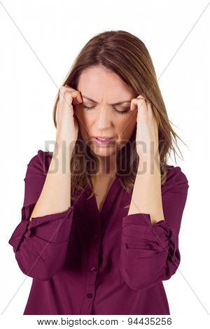 Pretty brunette with headache on white background