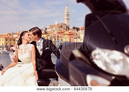 Bride And Groom Kissing In The City Near Motorbike