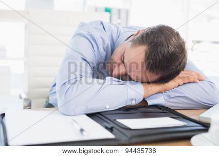 Sleeping businessman in his office