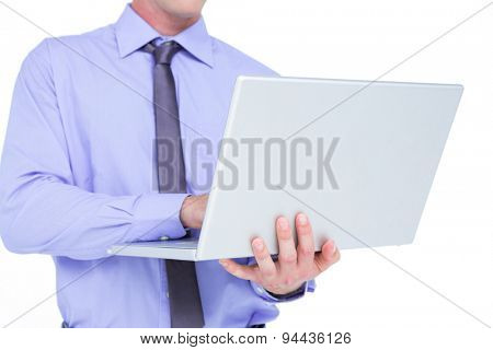Businessman using a laptop on a white background