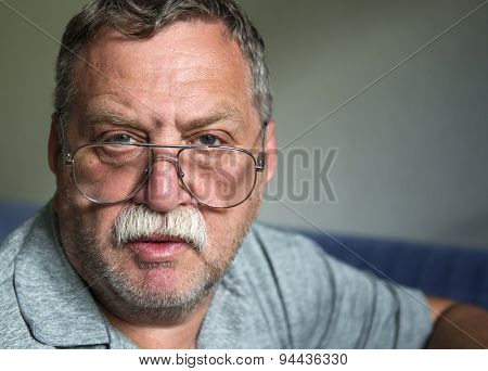Adult mustached man with glasses