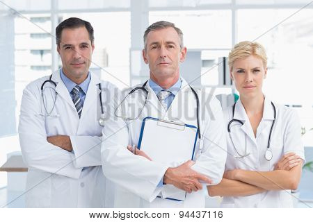 Concentrated doctors looking at camera in medical office