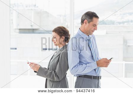 Businesswoman back-to-back with colleague in an office
